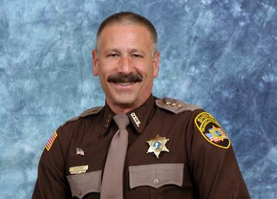 sheriff hatless mustache