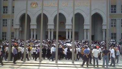 participants of the March of Justice at the stairs leading the Palace of Justice