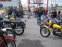 Folks gather around classic bikes at Brookside Motorcycle Company.