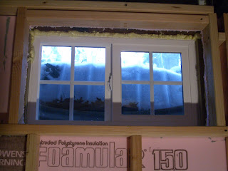 Make a farmhouse window add window trim to beef up a plain for Basement window replacement