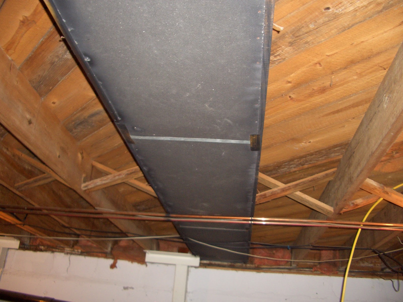 it started out as old 1945 bare wood and asbestos return air ducts