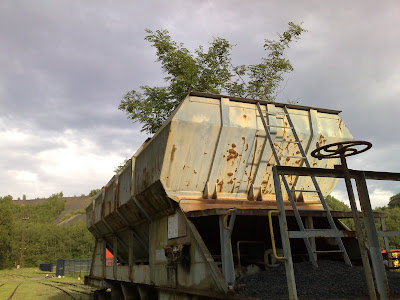 coal wagon, moody sky, tree