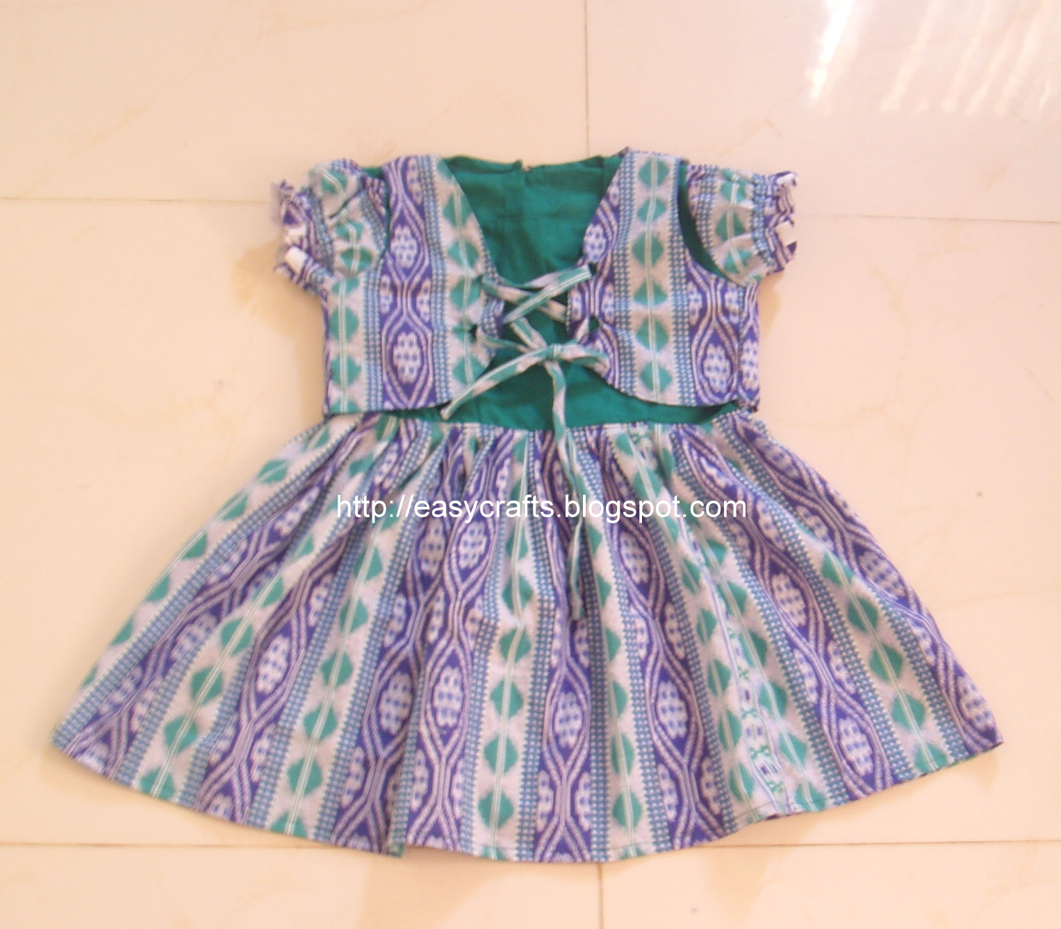 Baby Girls Frocks http://easycrafts.blogspot.com/2011/05/girl-baby-dress-with-coat.html