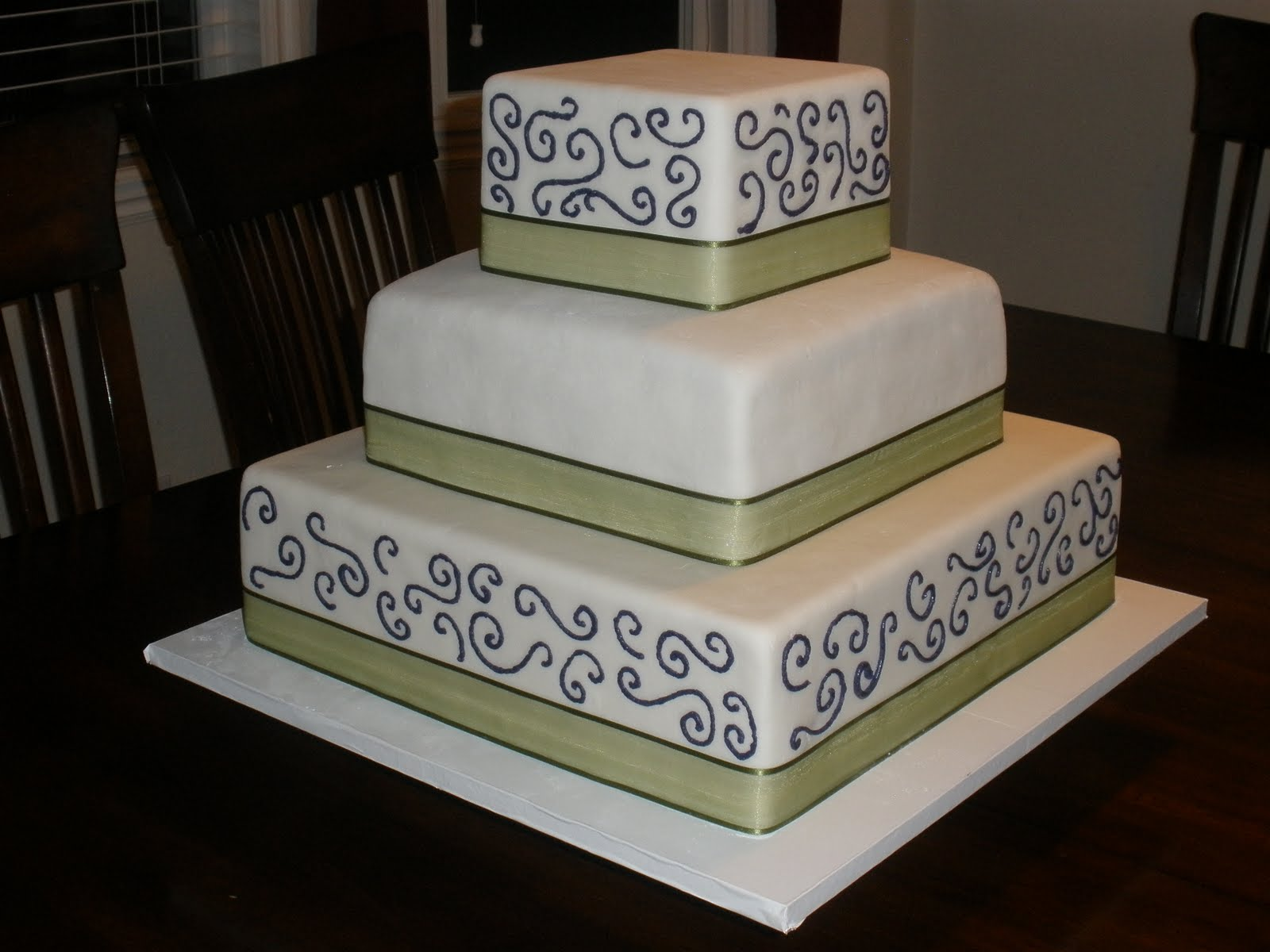 It s a piece of cake Square green & purple wedding cake