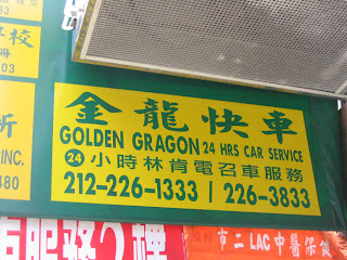 Sign for 'Golden Gragon' car service