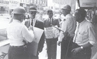 Civil rights activists Roy Wilkins and Medgar Evers being arrested