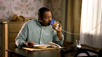 Man using soup-can telephone in a Progresso TV ad