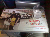 Airplane tray table with advertisement