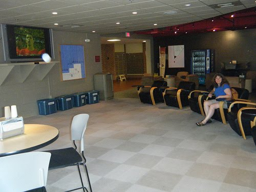 Pam Poses With Large Screen Television In An Otherwise Empty Room At  Bridgewater College Part 50