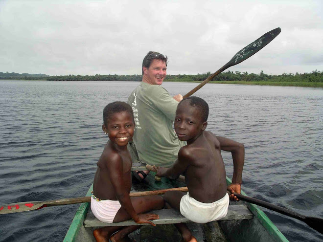 Paddling from the village of Nzulezu on Lake Tadane