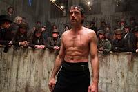Sherlock Holmes (Robert Downey) is boxing.