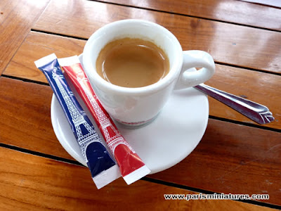 Sugar in Eiffel Tower sachets served with a cup of coffee