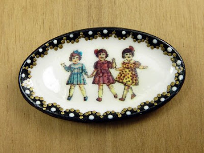 Hand painted miniature plate with a vintage nostalgic image