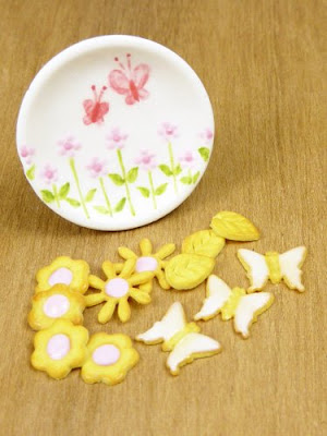Miniature Handpainted plate with flowers and butterflies complete with flower and butterfly cookies