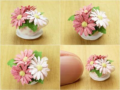Miniature flowers (gerberas) in teacup planter