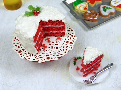 Miniature Red Velvet Christmas Cake with A Slice Cut and Served Alongside