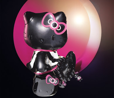 "Soft black pleather 14"" Hello Kitty doll in a 60&squot;s style black & white dress"