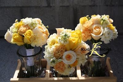 Yellow bouquets popped beautifully against the creamy yellow dresses