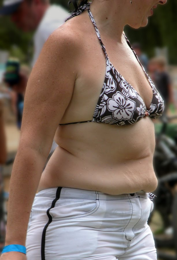 fat person in bikini. fat person in ikini. wearing