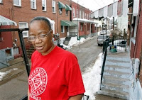 Curtis Mitchell's wife Sharon Edge outside thier home.  Photo from AP.