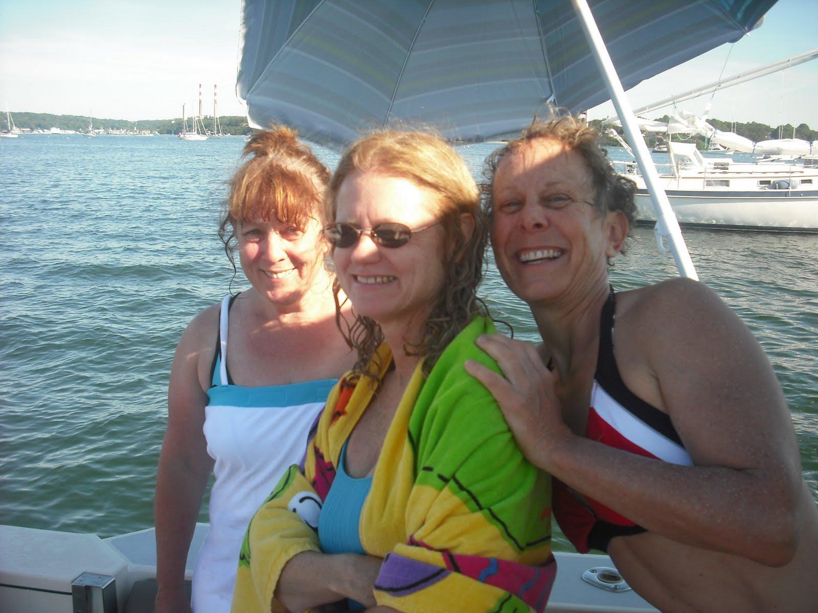 """Lori, Joyce, and Teri aboard """"Ebb Tide"""", Tim & Lori's new Albin 31."""