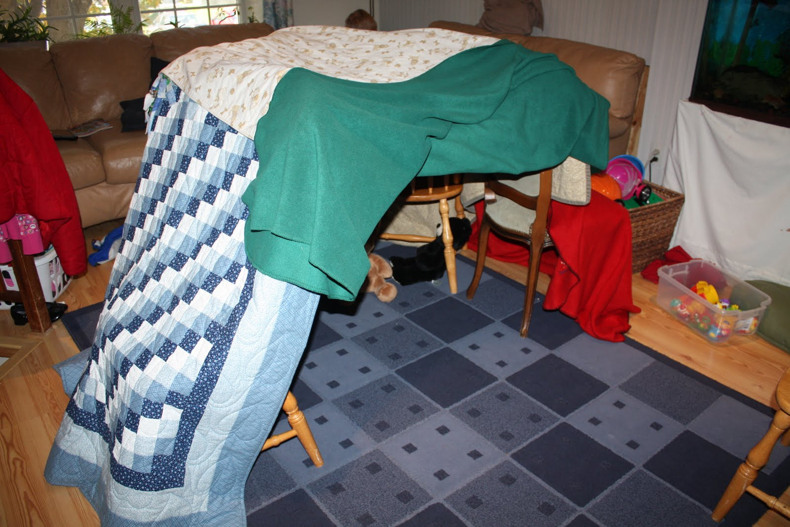 how to make a tent with chairs and blankets