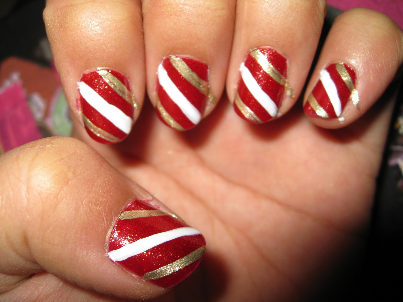 Taking the gold nail art polish, I made a gold diagonal stripe on