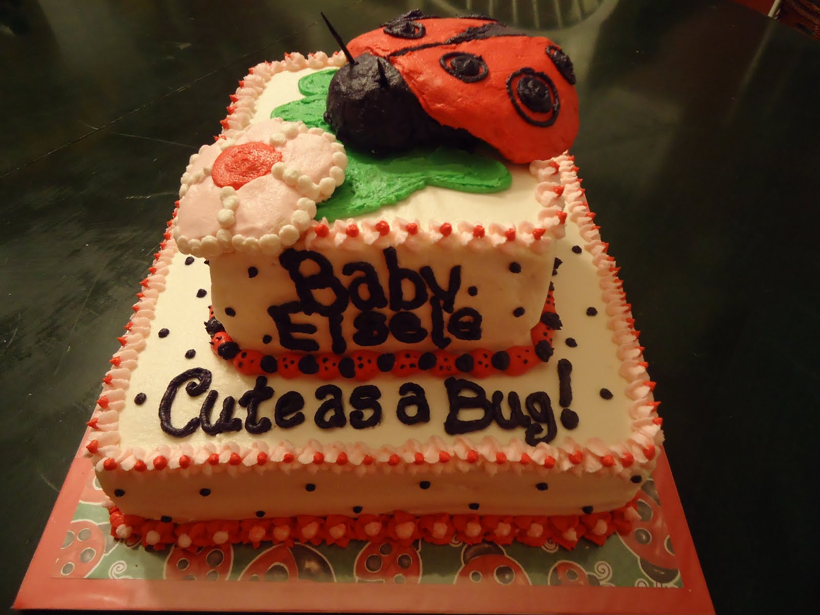 ... Cake With Chocolate Mousse Filling And Buttercream Frosting. The Ladybug  And Flower On Top Are Made From Rice Krispy Treat Covered With Buttercream.