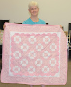 Eileen's peeking behind her baby quilt (djh evelyn's quilt retreat girl baby quilt)