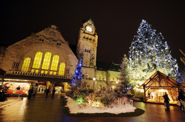 french railway station wallpaper. Visitors walk through the christmas market down the railway station on the