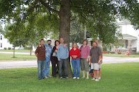 In front of the oak tree that we planted and named Roy-oak. L-R John, Lloyd, Beth, Brad, Lorrie, me, Sam and Craig
