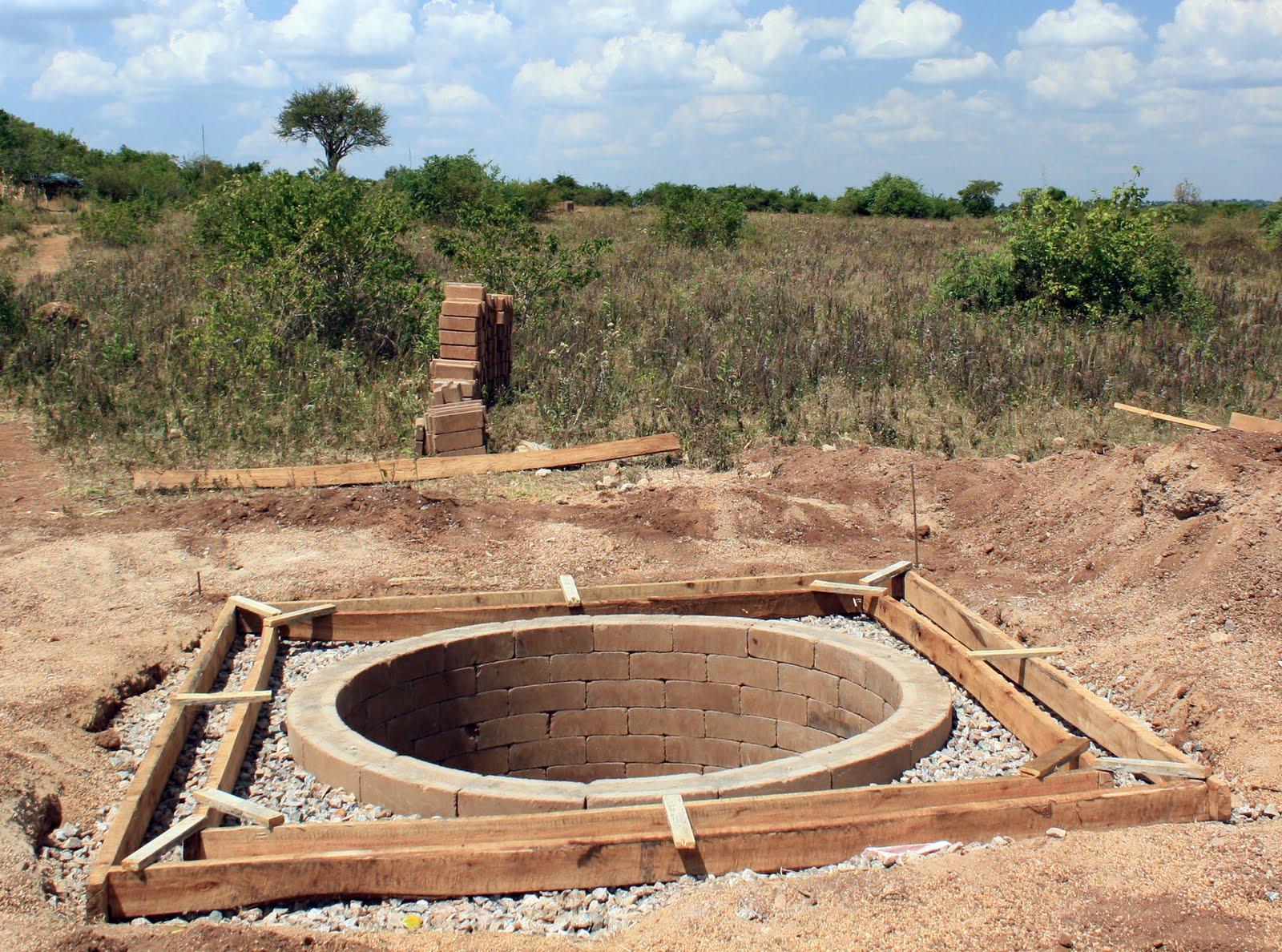 Pit Toilets Construction : Roche health center pit latrine underway