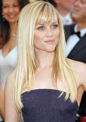 look great with this simple long hairstyle with an eye skimming fringe.