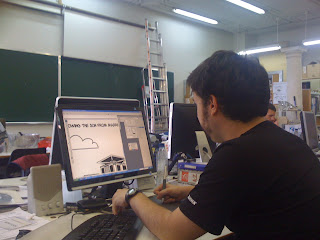 A team member working on the comic strips