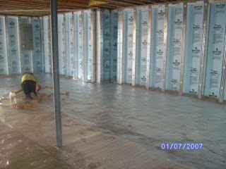 under construction basement vapor barrier electrical and meter boxes