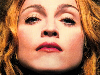 Madonna takes a swipe at Ritchie