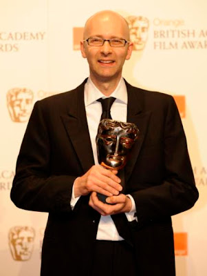 Chris Dickens poses with the award for Best Editing