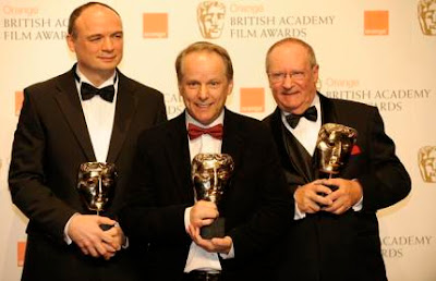British directors (L-R) Bob Parker, Nick Park and Steve Pegram pose with the award for Short Animation