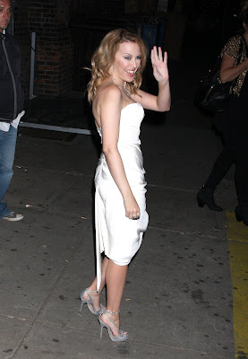 Kylie Minogue Cleavy looks Hot in White Dress photos
