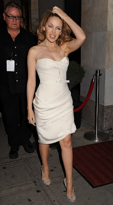 Kylie Minogue Cleavy looks Hot in White Dress photo