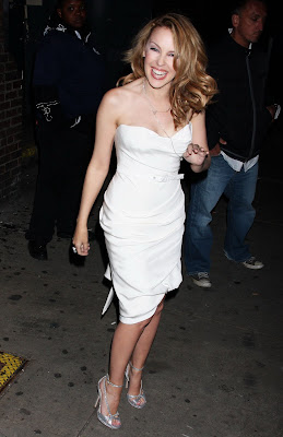 Kylie Minogue Cleavy looks Hot in White Dresss