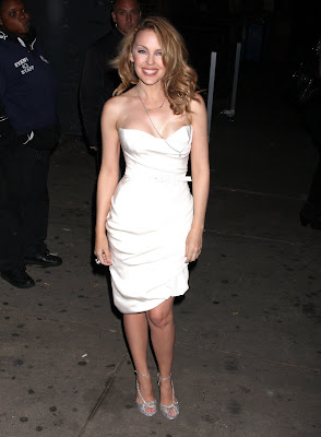 Kylie Minogue Cleavy looks Hot in White Dress hot photos