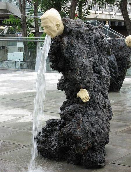 Rock Statue Man Barfing Water
