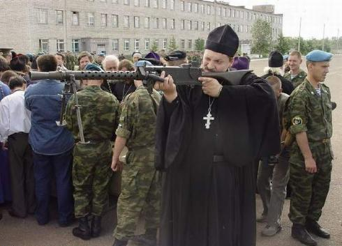 Priest With Giant Gun