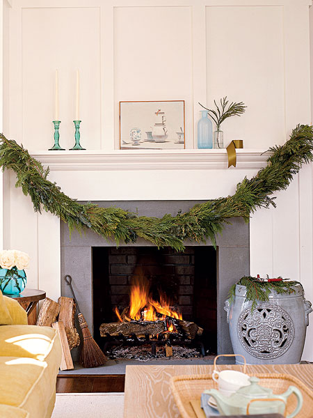 Loft cottage dressing up a fireplace for christmas for Christmas garland on fireplace