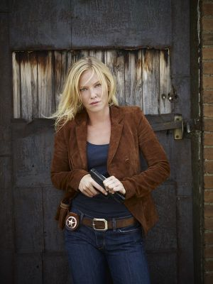 the lovely kelli giddish chase promo photoshoot sexy leg cross. Black Bedroom Furniture Sets. Home Design Ideas
