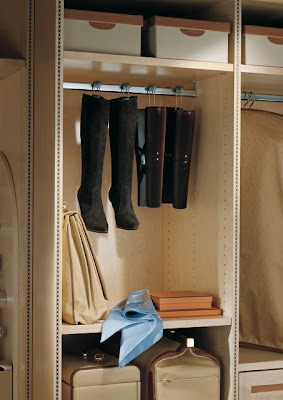 boots hanging in a closet