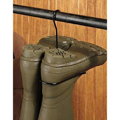 boot hanger with boots hanging upside down on a closet rod