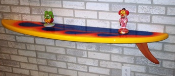 surfboard wall shelf with two small items on it