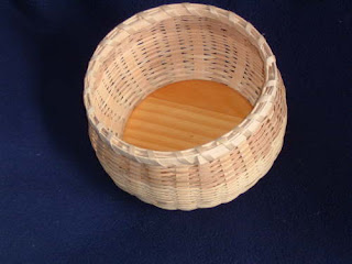 black ash basket with wooden bottom